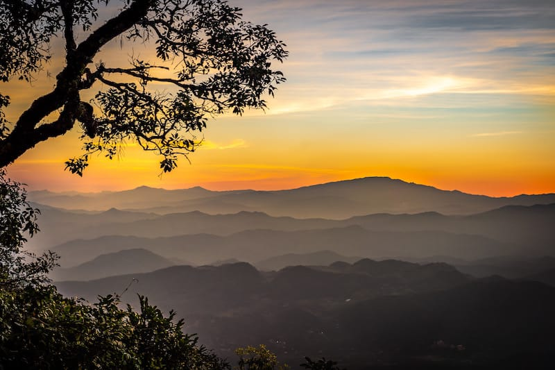 Beautiful sunset seen over smokey mountains north Thailand